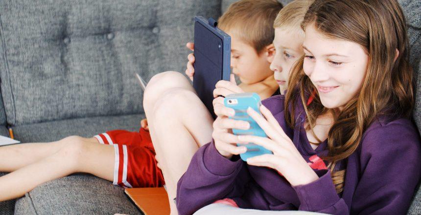 photo-of-kids-sitting-on-gray-sofa-4200826
